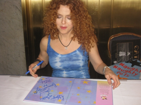 Bernadette Peters signs our book